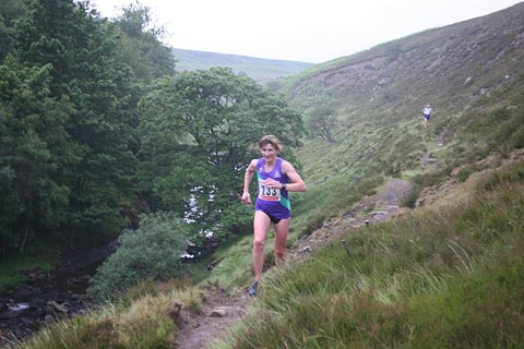 Karen Robertson striding out in the Saltwell Harriers Fell Race